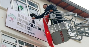 With consent of the municipality the sign of HDP is removed from the HDP building in Fethiye, March 2014