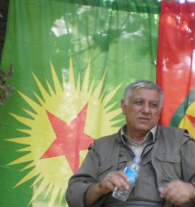 Don't be tricked by the bottle: one of the leaders of those holding the arms, KCK co-leader Cemil Bayik. (picture by me, July 2014)