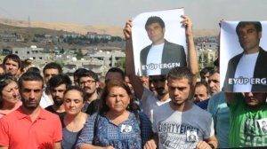 People in Sirnak protest the death of Eyüp Ergen, carrying his portrait.